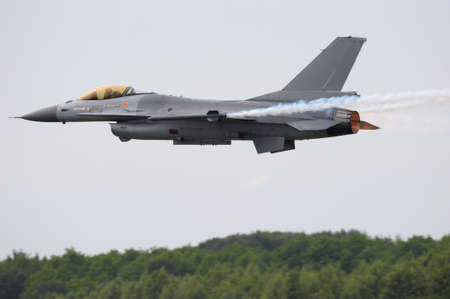 afterburner: F-16 Fighting Falcon military jet with afterburner Stock Photo
