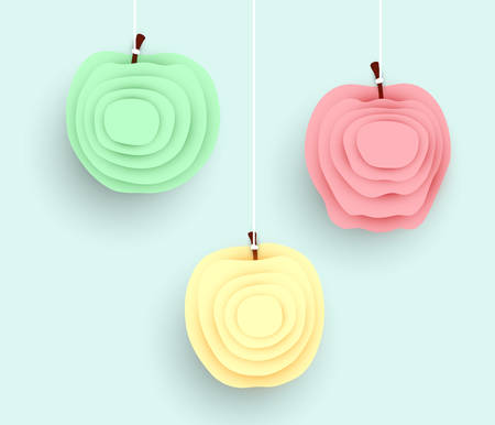 Red, green and yellow pastel paper cut apples hanging on white threads on a light blue background, colorful fruit themed design elements or templates Stock Illustratie
