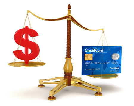 Justice Balance  with Credit Card and dollar  clipping path included  photo