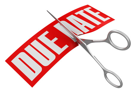 due date: Scissors and due date  Stock Photo