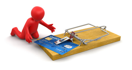 Man and mousetrap with Credit Card  clipping path included  photo
