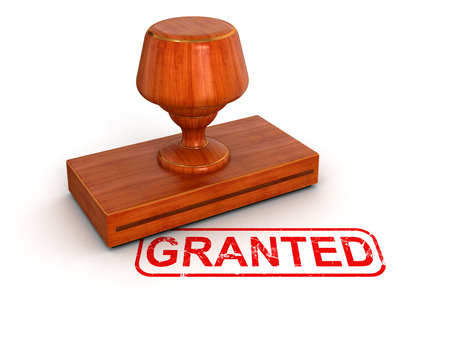 Rubber Stamp granted   clipping path included  photo