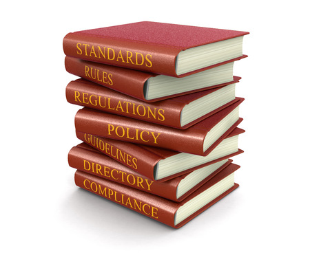 Stack of compliance and rules books Stok Fotoğraf