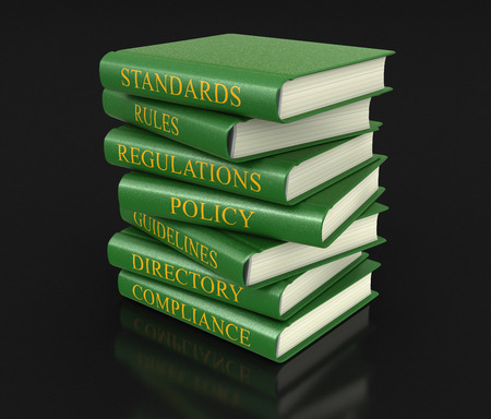 guide book: Stack of compliance and rules books