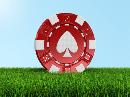 isolatedrn: chip of casino on grass (clipping path included)