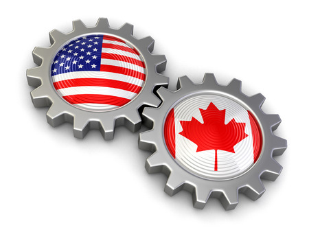 usa flag: USA and Canadian flags on a gears (clipping path included) Stock Photo