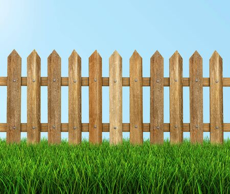 Wooden fence on grass clipping path included Stok Fotoğraf