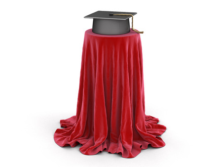 Graduation cap on table covered cloth. Stock Photo