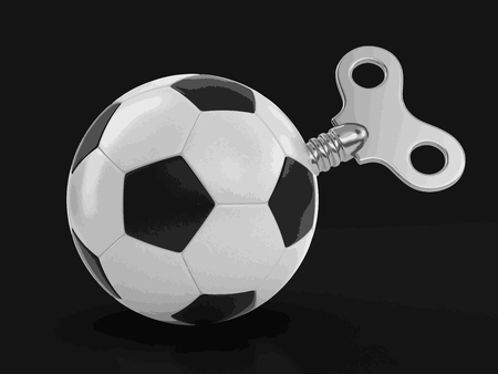 Soccer football with winding key. Image with clipping path
