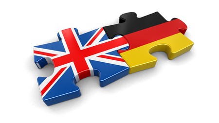 UK and Germany puzzle from flags. Image with clipping path Stock Photo