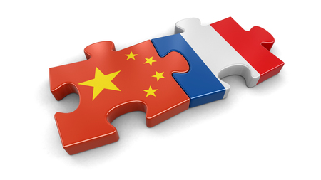 China and France puzzle from flags. Image with clipping path