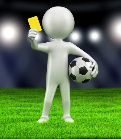 Referee holds up yellow card Stock Photo
