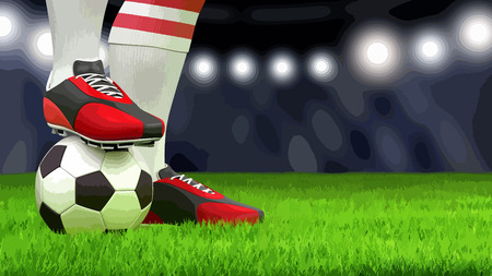 Man with a soccer ball on grass