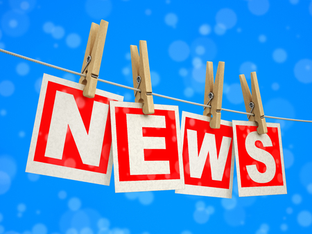 Wooden clothespins on rope with News. Stock Photo