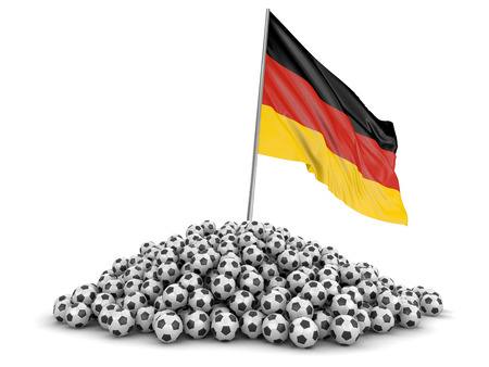 Pile of Soccer footballs and German flag. Image with clipping path Standard-Bild - 101752319
