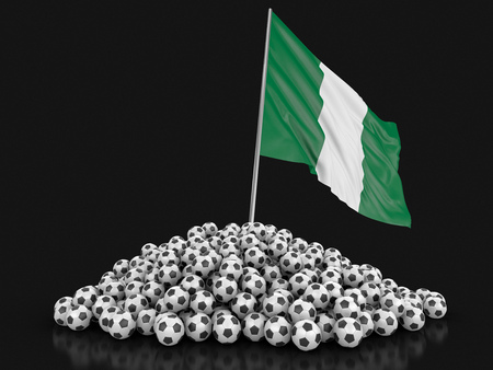 Soccer footballs with Nigerian flag. Image with clipping path