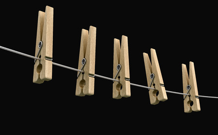 Wooden clothespins on rope. Image with clipping path Reklamní fotografie