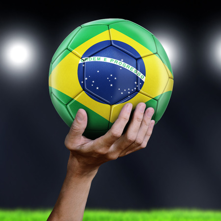 Man holding Soccer ball with Brazilian flag