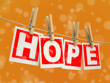 Wooden clothespins on a rope with Hope. Image with clipping path Stock Photo