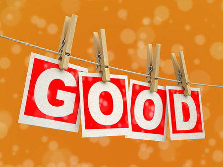 Wooden clothespins on the rope with Good. Image with clipping path