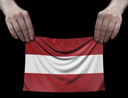 Latvian flag in hands Banco de Imagens - 107858930