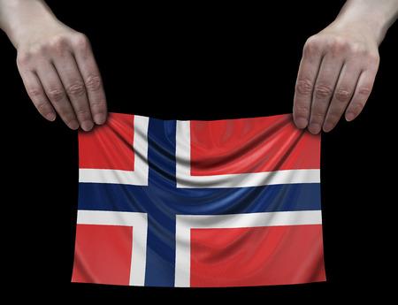 Norwegian flag in hands