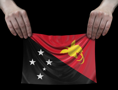 Papua New Guinea flag in hands