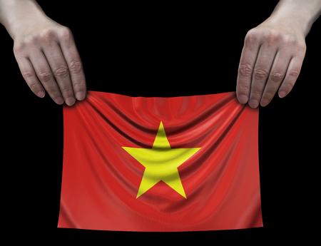 Vietnamese flag in hands Banco de Imagens - 108868709