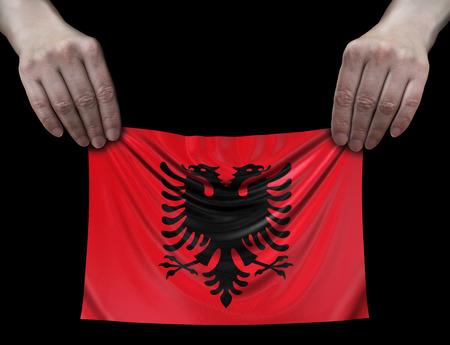 Albanian flag in hands Imagens