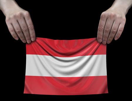 Austrian flag in hands Imagens