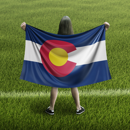 Women and Colorado flag