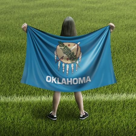 Women and Oklahoma flag
