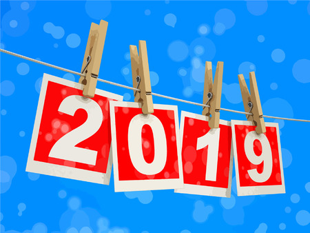Clothespins on rope with 2019. Image with clipping path
