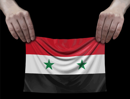 Syrian flag in hands