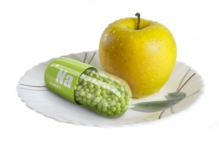 Yellow apple on a white plate