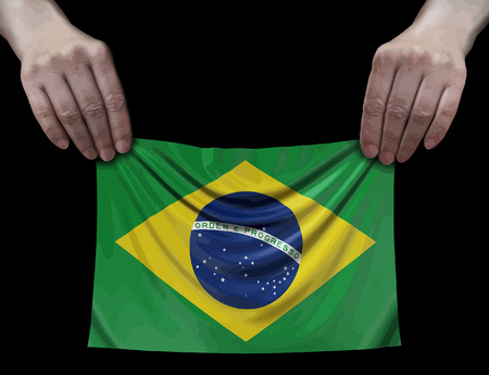 Brazilian flag in hands