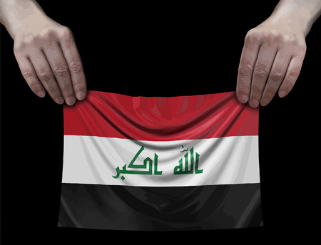 Iraq flag in hands
