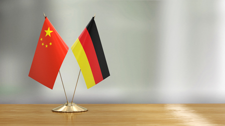 Chinese and German flag pair on a desk 免版税图像