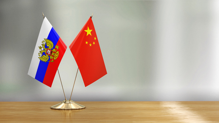 Russian and Chinese flags Reklamní fotografie