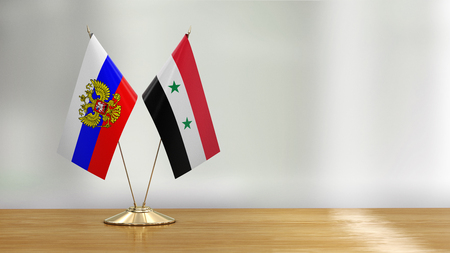 Syrian and Russian flag pair over defocused background