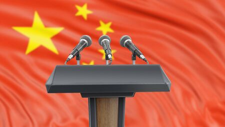 Podium lectern with microphones and Chinese flag in background