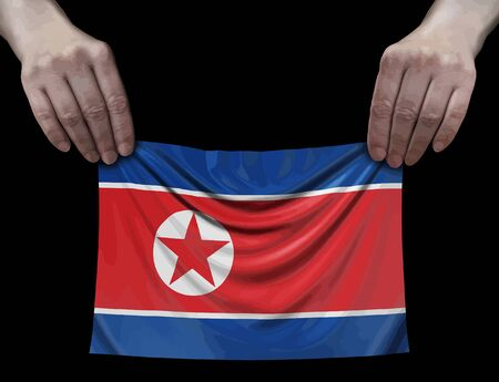 North Korean flag in hands