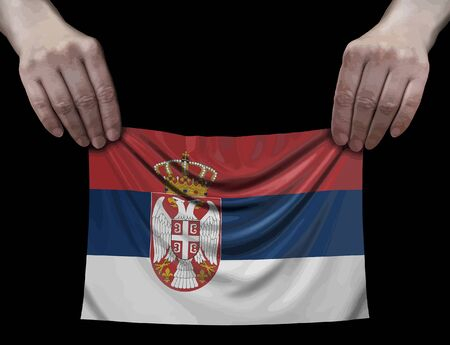 Serbian flag in hands