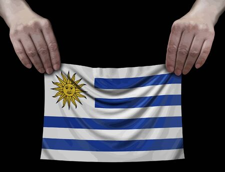 Uruguayan flag in hands