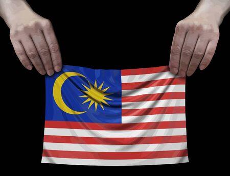 Malaysia flag in hands Ilustração