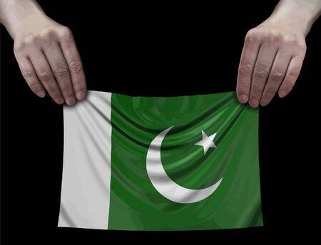 Pakistan Flag in hands