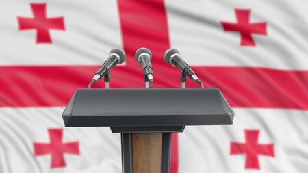 Podium lectern with microphones and Georgian flag in background Reklamní fotografie
