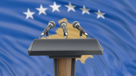 Podium lectern with microphones and Kosovo flag in background