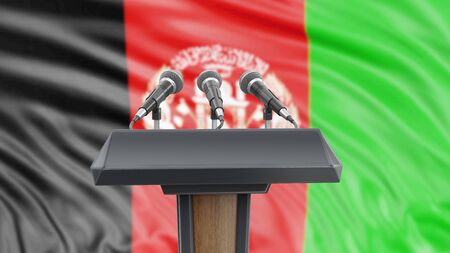 Podium lectern with microphones and Afghan flag in background Reklamní fotografie