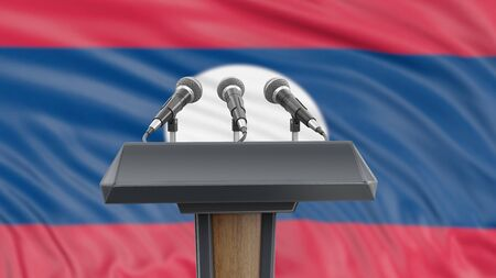 Podium lectern with microphones and Laos flag in background Reklamní fotografie